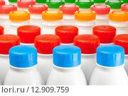 Купить «Молочные продукты в пластиковых бутылках с яркими крышками разных цветов на белом фоне», фото № 12909759, снято 23 марта 2012 г. (c) Куликов Константин / Фотобанк Лори