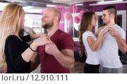 Купить «Group dancing in club», фото № 12910111, снято 25 марта 2019 г. (c) Яков Филимонов / Фотобанк Лори