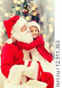 Купить «smiling little girl with santa claus», фото № 12911363, снято 14 сентября 2014 г. (c) Syda Productions / Фотобанк Лори