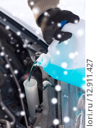 Купить «closeup of man pouring antifreeze into car», фото № 12911427, снято 16 января 2014 г. (c) Syda Productions / Фотобанк Лори
