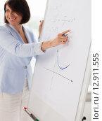 Купить «smiling math teacher at flipboard in classroom», фото № 12911555, снято 16 июня 2013 г. (c) Syda Productions / Фотобанк Лори