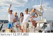 Купить «smiling friends sailing on yacht», фото № 12911883, снято 13 июля 2014 г. (c) Syda Productions / Фотобанк Лори