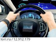 Купить «close up of man driving car with graph on screen», фото № 12912179, снято 17 июля 2015 г. (c) Syda Productions / Фотобанк Лори