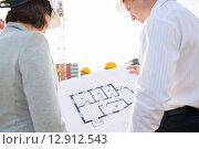 Купить «close up of architects with blueprint at building», фото № 12912543, снято 21 сентября 2014 г. (c) Syda Productions / Фотобанк Лори