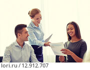Купить «smiling business people with papers in office», фото № 12912707, снято 25 октября 2014 г. (c) Syda Productions / Фотобанк Лори