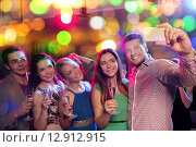 Купить «friends with glasses and smartphone in club», фото № 12912915, снято 20 октября 2014 г. (c) Syda Productions / Фотобанк Лори