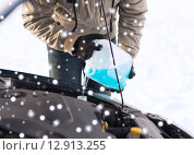 Купить «closeup of man pouring antifreeze into car», фото № 12913255, снято 16 января 2014 г. (c) Syda Productions / Фотобанк Лори