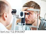 Купить «Ophthalmology eyesight examination», фото № 12914047, снято 13 февраля 2015 г. (c) Дмитрий Калиновский / Фотобанк Лори