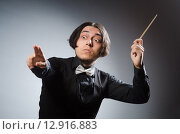 Купить «Funny conductor in musical concept», фото № 12916883, снято 1 августа 2015 г. (c) Elnur / Фотобанк Лори