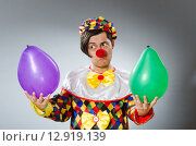 Clown with balloons in funny concept. Стоковое фото, фотограф Elnur / Фотобанк Лори