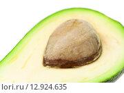 Разрезанный авокадо с косточкой. Стоковое фото, фотограф Фрибус Екатерина / Фотобанк Лори