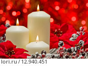 White candles in autumn winter decoration. Стоковое фото, фотограф Ulrich Schade / PantherMedia / Фотобанк Лори