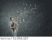 Купить «Handsome saxophonist. Concept image», фото № 12954327, снято 24 января 2019 г. (c) Sergey Nivens / Фотобанк Лори