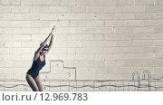 Купить «Female swimmer. Concept image», фото № 12969783, снято 8 февраля 2014 г. (c) Sergey Nivens / Фотобанк Лори