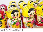 Купить «Красочные матрешки, русский сувенир», фото № 13004511, снято 30 октября 2015 г. (c) EugeneSergeev / Фотобанк Лори