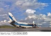 Купить «Крупнейший в мире грузовой самолет Руслан (Ан-124-100) на погрузке в аэропорту города Морсби (Папуа Новая Гвинея)», фото № 13004895, снято 19 июня 2013 г. (c) oleg savichev / Фотобанк Лори