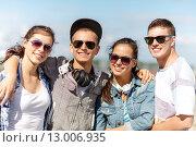 Купить «smiling teenagers in sunglasses hanging outside», фото № 13006935, снято 20 июля 2013 г. (c) Syda Productions / Фотобанк Лори