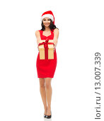 Купить «beautiful sexy woman in santa hat with gift box», фото № 13007339, снято 25 сентября 2015 г. (c) Syda Productions / Фотобанк Лори