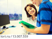 Купить «school boy with notebook and teacher in classroom», фото № 13007559, снято 15 ноября 2014 г. (c) Syda Productions / Фотобанк Лори