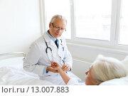 Купить «doctor checking senior woman pulse at hospital», фото № 13007883, снято 11 июня 2015 г. (c) Syda Productions / Фотобанк Лори