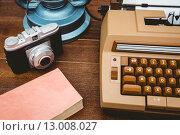 Купить «View of an old typewriter and camera», фото № 13008027, снято 18 мая 2015 г. (c) Wavebreak Media / Фотобанк Лори