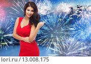 Купить «beautiful sexy woman in red dress over firework», фото № 13008175, снято 25 сентября 2015 г. (c) Syda Productions / Фотобанк Лори