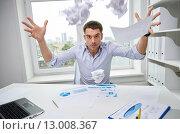 Купить «angry businessman throwing papers in office», фото № 13008367, снято 18 июня 2015 г. (c) Syda Productions / Фотобанк Лори