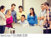 group of students and teacher with laptop. Стоковое фото, фотограф Syda Productions / Фотобанк Лори