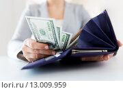 Купить «close up of woman hands with wallet and money», фото № 13009959, снято 2 июля 2015 г. (c) Syda Productions / Фотобанк Лори