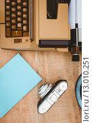 Купить «View of an old typewriter and camera», фото № 13010251, снято 18 мая 2015 г. (c) Wavebreak Media / Фотобанк Лори