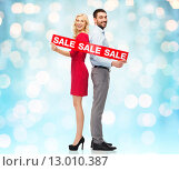 Купить «couple with red sale sign standing to back», фото № 13010387, снято 3 октября 2015 г. (c) Syda Productions / Фотобанк Лори