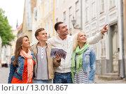 Купить «group of friends with city guide exploring town», фото № 13010867, снято 14 июня 2014 г. (c) Syda Productions / Фотобанк Лори