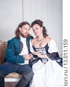 Купить «Мужчина и женщина в средневековой одежде», фото № 13011159, снято 23 августа 2015 г. (c) Darkbird77 / Фотобанк Лори