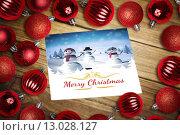 Купить «Composite image of christmas baubles on table», фото № 13028127, снято 23 июля 2019 г. (c) Wavebreak Media / Фотобанк Лори