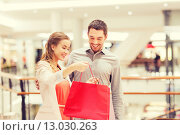 Купить «happy young couple with shopping bags in mall», фото № 13030263, снято 10 ноября 2014 г. (c) Syda Productions / Фотобанк Лори