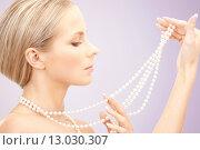 Купить «beautiful woman with pearl necklace over violet», фото № 13030307, снято 30 октября 2010 г. (c) Syda Productions / Фотобанк Лори