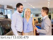 Купить «happy couple with car dealer in auto show or salon», фото № 13030479, снято 22 января 2015 г. (c) Syda Productions / Фотобанк Лори