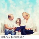 Купить «happy family with book at home», фото № 13030587, снято 1 марта 2014 г. (c) Syda Productions / Фотобанк Лори