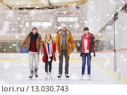 Купить «happy friends on skating rink», фото № 13030743, снято 26 ноября 2014 г. (c) Syda Productions / Фотобанк Лори