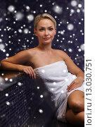 Купить «beautiful woman sitting in bath towel at sauna», фото № 13030751, снято 15 декабря 2014 г. (c) Syda Productions / Фотобанк Лори
