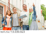 Купить «group of smiling friends with map and photocamera», фото № 13030823, снято 14 июня 2014 г. (c) Syda Productions / Фотобанк Лори