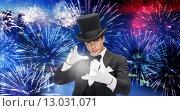 Купить «magician in top hat showing trick», фото № 13031071, снято 12 сентября 2013 г. (c) Syda Productions / Фотобанк Лори