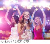Купить «happy women singing karaoke and dancing», фото № 13031079, снято 20 октября 2013 г. (c) Syda Productions / Фотобанк Лори