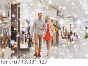 Купить «happy young couple with shopping bags in mall», фото № 13031127, снято 10 ноября 2014 г. (c) Syda Productions / Фотобанк Лори