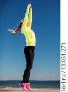 Купить «woman doing yoga outdoors», фото № 13031271, снято 19 июня 2013 г. (c) Syda Productions / Фотобанк Лори