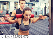 Купить «man and woman with barbell flexing muscles in gym», фото № 13032075, снято 30 ноября 2014 г. (c) Syda Productions / Фотобанк Лори