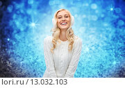 Купить «smiling young woman in winter earmuffs and sweater», фото № 13032103, снято 8 октября 2015 г. (c) Syda Productions / Фотобанк Лори