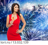 Купить «beautiful woman with champagne glass over firework», фото № 13032139, снято 25 сентября 2015 г. (c) Syda Productions / Фотобанк Лори
