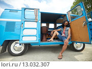 Купить «smiling young hippie man in minivan car», фото № 13032307, снято 27 августа 2015 г. (c) Syda Productions / Фотобанк Лори