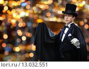 Купить «magician in top hat showing trick with magic wand», фото № 13032551, снято 12 сентября 2013 г. (c) Syda Productions / Фотобанк Лори